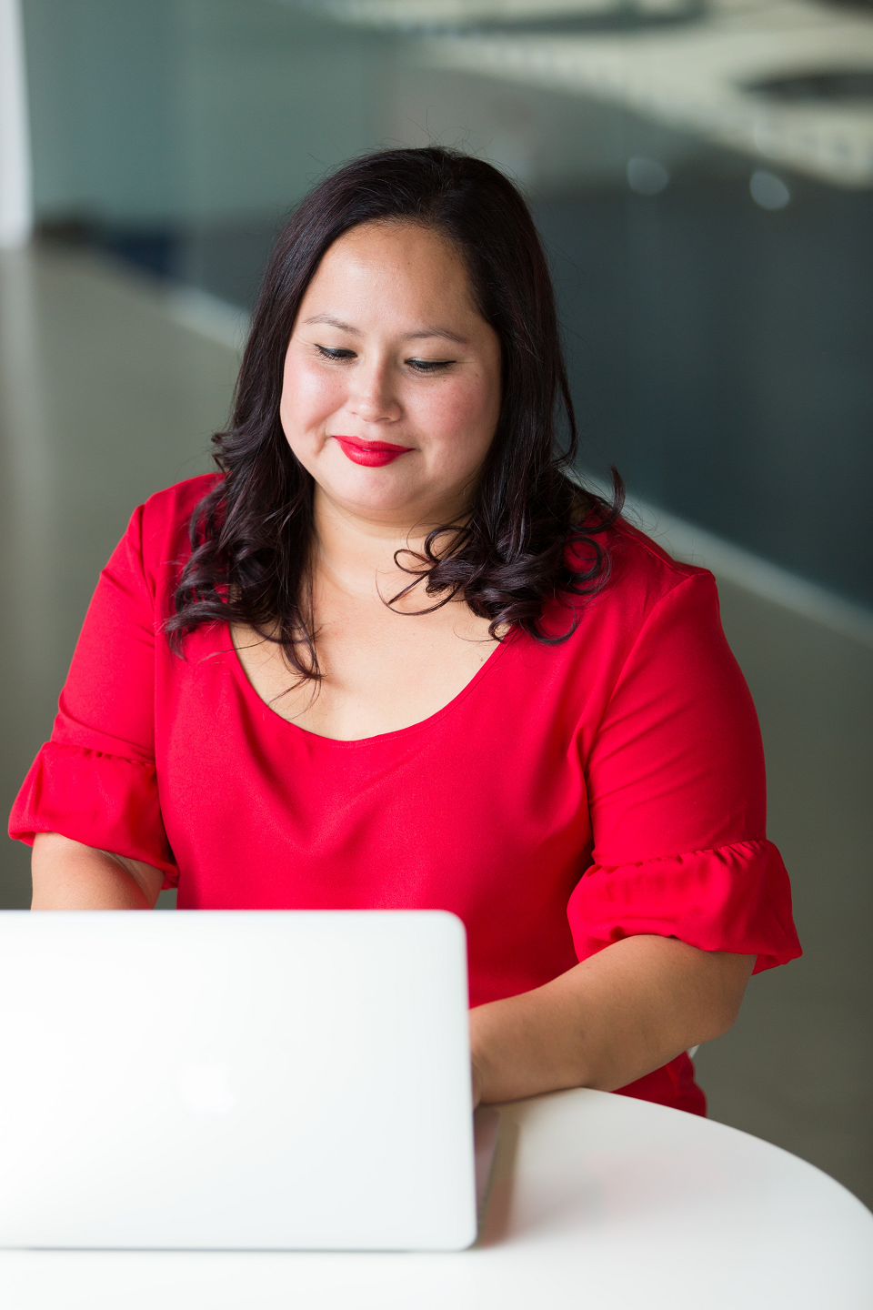 woman in red dress typing